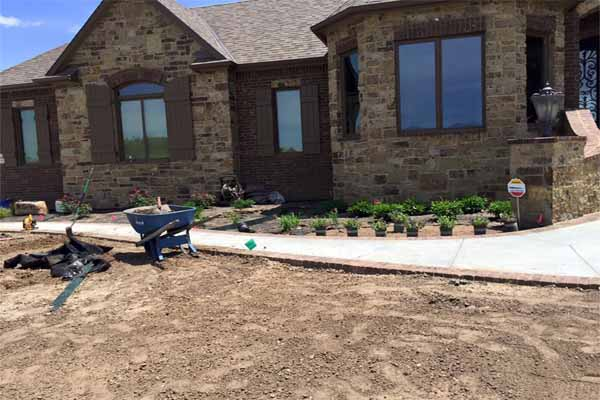 A Boston North Shore home improvement project doesn't usually include landscaping your new home, but it should.
